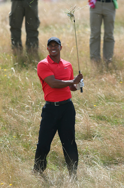 . Tiger Woods of the US plays out of the rough on the 12th hole during the final round of the British Open Golf championship at the Royal Liverpool golf club, Hoylake, England, Sunday July 20, 2014. (AP Photo/Jon Super)