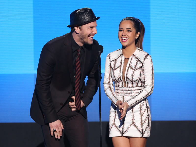 . Gavin DeGraw, left, and Becky G present a performance by 5 Seconds of Summer at the 42nd annual American Music Awards at Nokia Theatre L.A. Live on Sunday, Nov. 23, 2014, in Los Angeles. (Photo by Matt Sayles/Invision/AP)