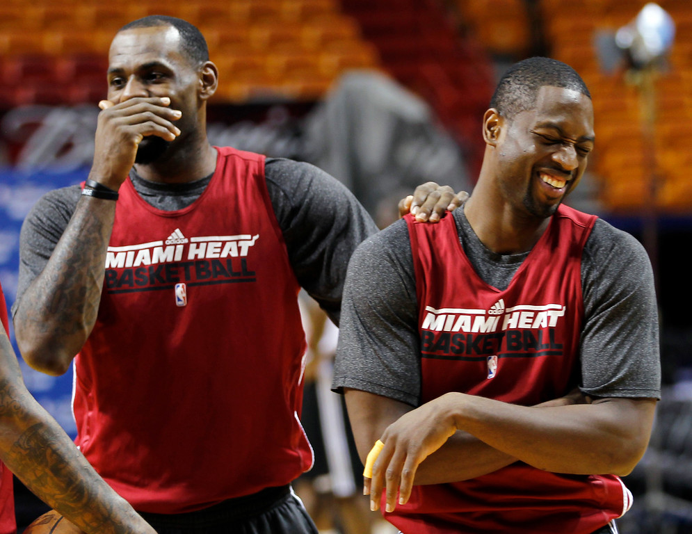. Miami Heat small forward LeBron James, left, and shooting guard Dwyane Wade joke during practice, Wednesday, June 20, 2012, in Miami. The Heat play Game 5 against the Oklahoma City Thunder on Thursday. (AP Photo/Alan Diaz)
