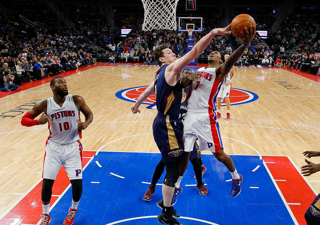 . Detroit Pistons guard Brandon Jennings (7) drives on New Orleans Pelicans center Omer Asik (3) during the second half of an NBA basketball game in Auburn Hills, Mich., Wednesday, Jan. 14, 2015. (AP Photo/Paul Sancya)