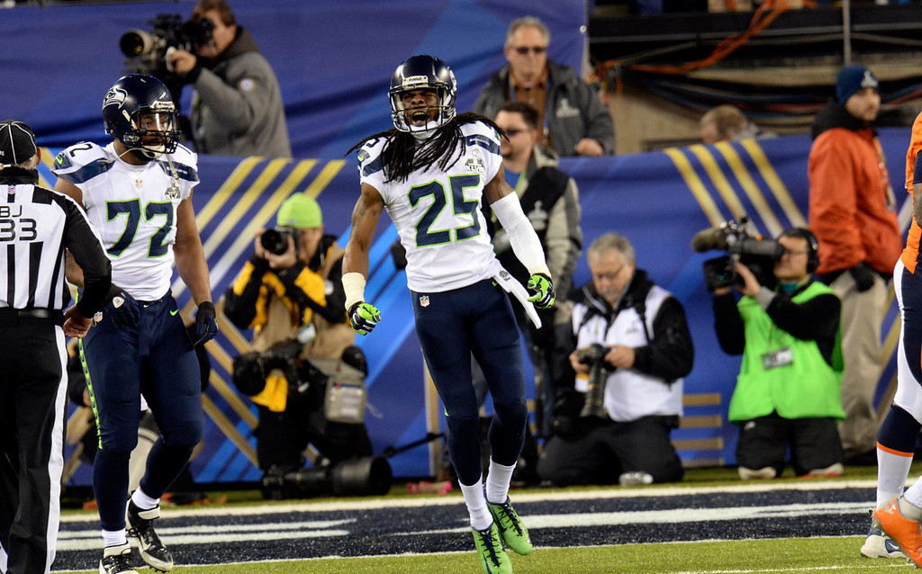 . Seattle Seahawks cornerback Richard Sherman (25) celebrates  after the Seahawks scored a safety 12 seconds into the game.  The Denver Broncos vs the Seattle Seahawks in Super Bowl XLVIII at MetLife Stadium in East Rutherford, New Jersey Sunday, February 2, 2014. (Photo by Hyoung Chang//The Denver Post)