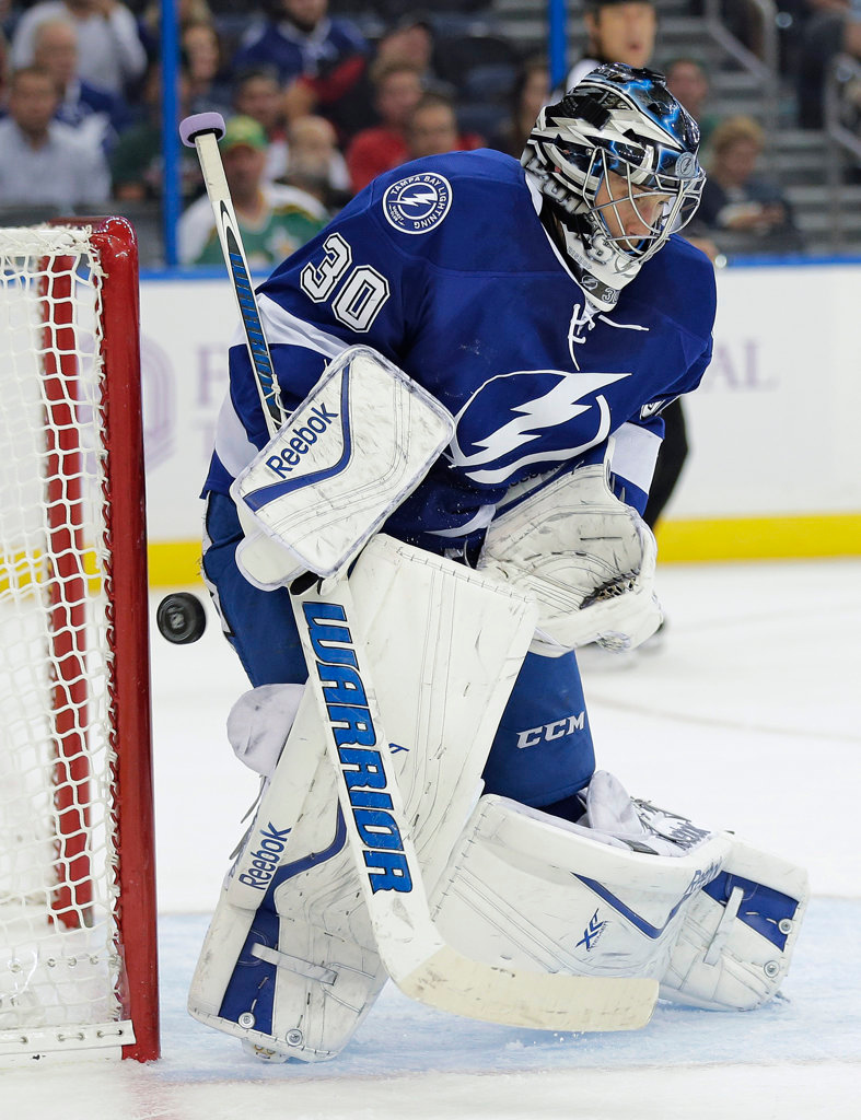 . Tampa Bay Lightning goalie Ben Bishop makes a save on a shot by the Minnesota Wild during the first period. (AP Photo/Chris O\'Meara)