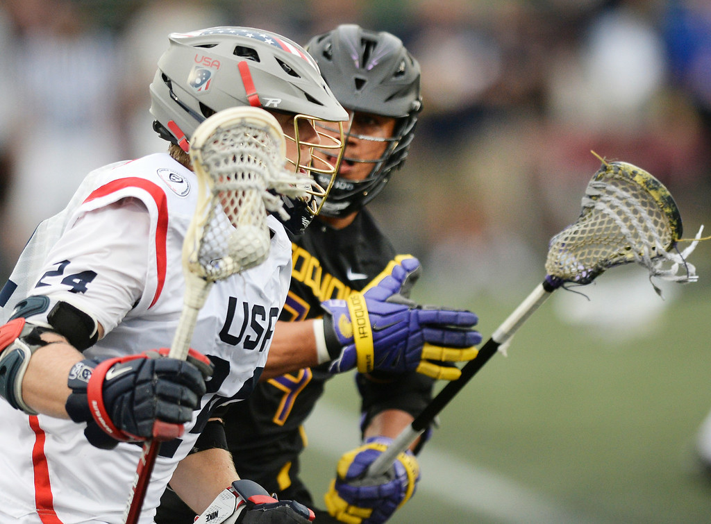 . United States midfielder Chris Eck (24) made a run shadowed by Iroquois midfielder Jeremy Thompson (74) in the first half of their game in the 2014 World Lacrosse Championships on Tuesday, July 15, 2014, at Dick\'s Sporting Goods Park in Commerce City, Colorado.    Photo by Karl Gehring/The Denver Post