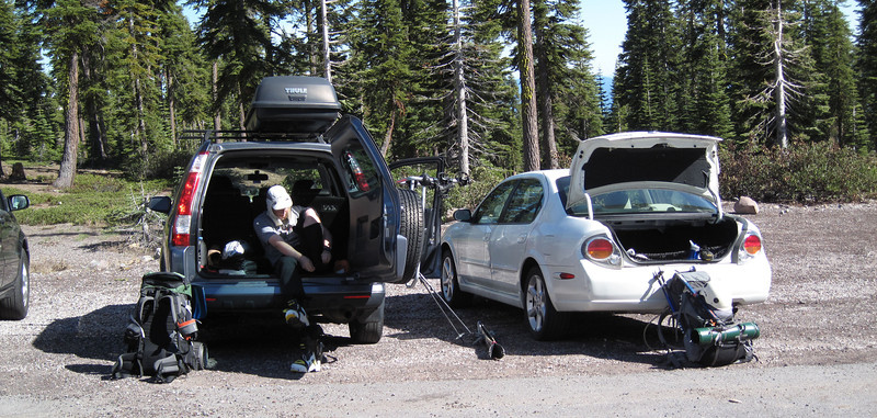 Jeff gets his ski boots on. My gear at the right. Jeff drove down from Portland, and I drove up from Santa Rosa to meet him. Jeff skis while I walk. Our gear consists of campons, ice axe, helmets, a tent, sleeping bags and pads, dry food, camp stove, and lots of warm clothes.