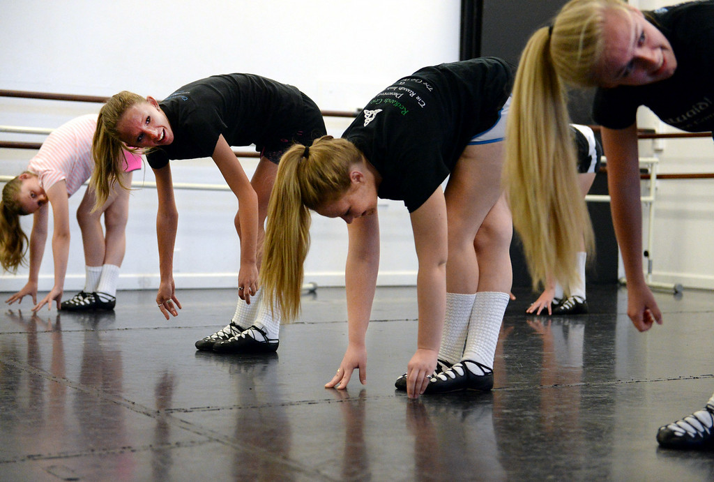 . From left, Cienna Short, 11, Gina Goldschmidt, 15, Megan Tomerlin, 17, and Jenna Rolf, 17, of the Tir Ruaidh Irish Dance Company, participate in rehearsal on Thursday, June, 26, 2014 at School of International Ballet in Redlands, Ca. The company has enjoyed much success over the last year, with multiple dancers winning and placing in The World Irish Dance Associations� European and World Championships. (Photo by Micah Escamilla/Redlands Daily Facts)