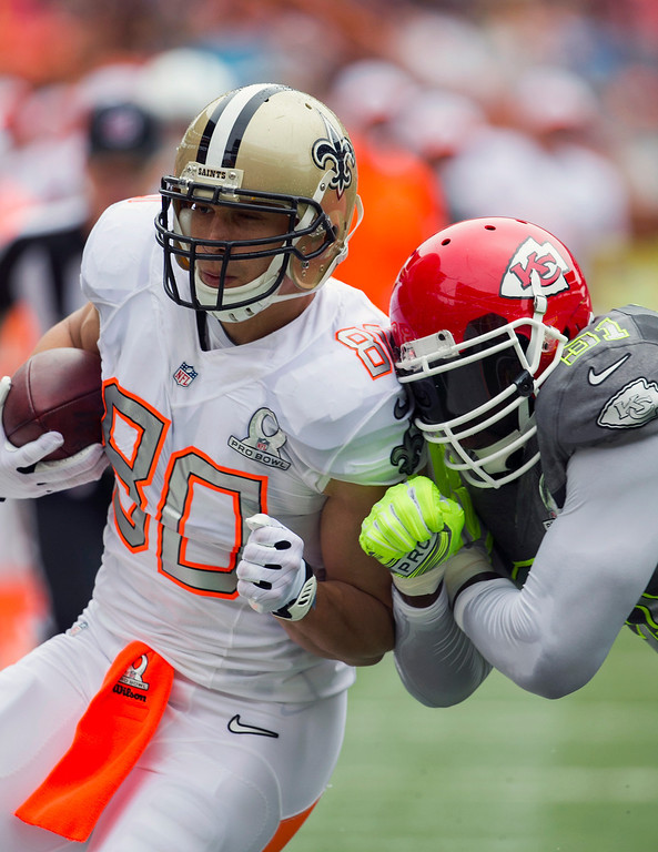 . New Orleans Saints tight end Jimmy Graham (80), of Team Rice, gets pushed out of bounds by Kansas City Chiefs linebacker Tamba Hali (91), of Team Sanders, during the first quarter at the NFL Pro Bowl football game at Aloha Stadium, Sunday. Jan. 26, 2014, in Honolulu.  (AP Photo/Marco Garcia)