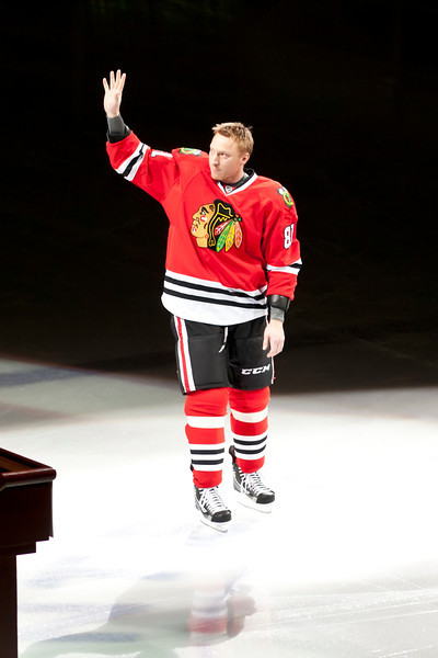Marion Hossa greeting a boisterous crowd celebrating his 1000th NHL game.