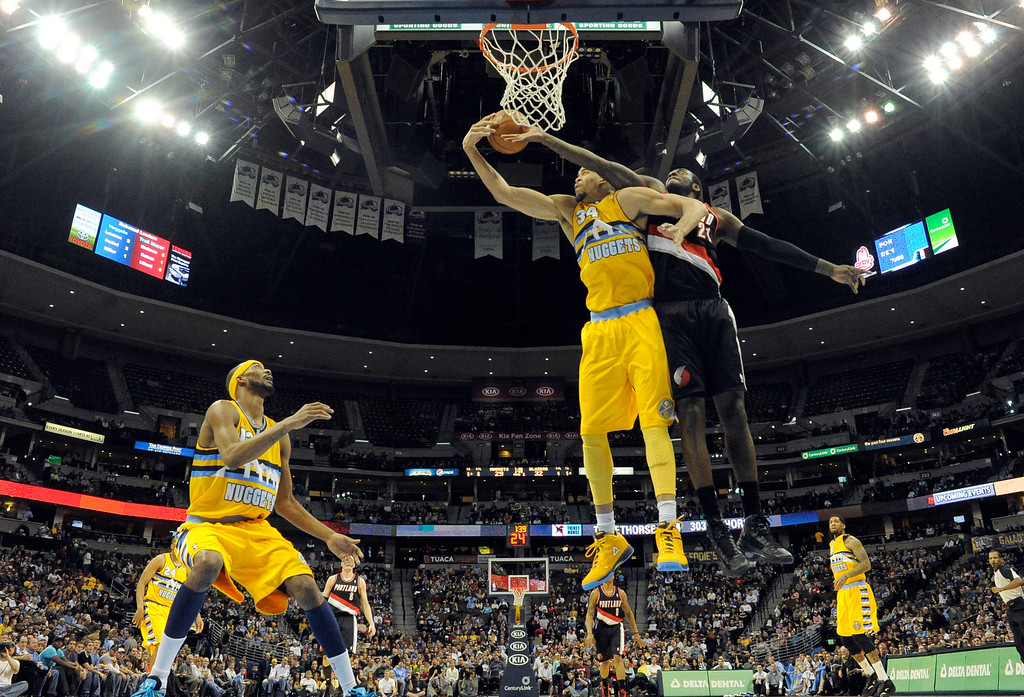 . Denver Nuggets center JaVale McGee (34) hauls down a rebound from Portland Trail Blazers center J.J. Hickson (21) Tuesday, January 15, 2013 at Pepsi Center. John Leyba, The Denver Post