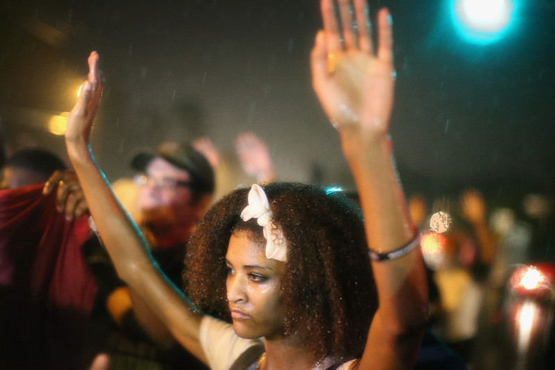 . People wait for reaction from police after they refused to honor the midnight curfew on August 17, 2014 in Ferguson, Missouri. The curfew was imposed on Saturday in an attempt to reign in the violence that has erupted nearly every night in the suburban St. Louis town since the shooting death of teenager Michael Brown by a Ferguson police officer on August 9.  (Photo by Scott Olson/Getty Images)