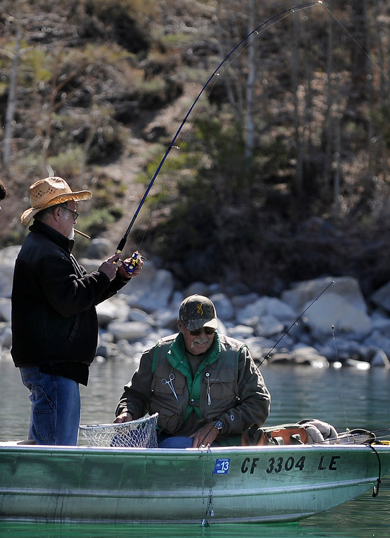 . A fisherman on June Lake tries to bring his fish to the boat on opening day of Trout Fishing Season in the Eastern Sierra. The fish broke the line just moments before it could be scooped into a net. June Lake, CA 4/27/2013(John McCoy/Staff Photographer)