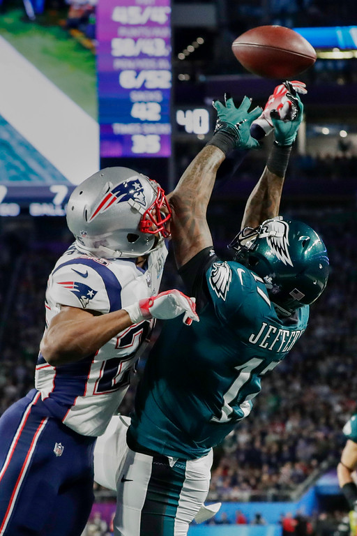 . New England Patriots cornerback Eric Rowe (25) breaks up a pass in the end zone intended for Philadelphia Eagles wide receiver Alshon Jeffery (17), during the first half of the NFL Super Bowl 52 football game Sunday, Feb. 4, 2018, in Minneapolis. (AP Photo/Frank Franklin II)