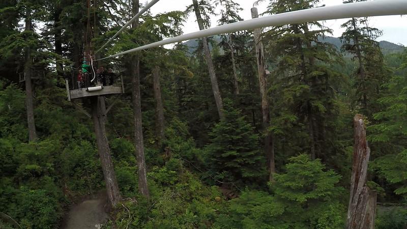 Susan approaches the zipline landing platform