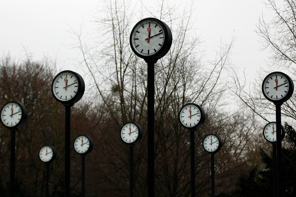 Description of . Clocks with the time reading 12:12 are pictured in a park in Duesseldorf December 12, 2012.  Wednesday December 12, 2012, is the last day in this century where the numeral date can be all the same number.  REUTERS/Ina Fassbender