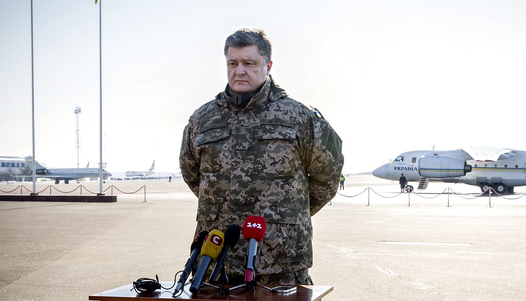 . Ukrainian President Petro Poroshenko speaks to press at Borispol airport outside Kiev, Ukraine on Wednesday, Feb. 18, 2015. The army has withdrawn 80 percent of its troops from the town Debaltseve and two more columns have yet to leave, Ukrainian President Petro Poroshenko said Wednesday. He denied claims by the rebels that the Ukrainians were surrounded and said the troops were leaving Debaltseve with their weapons and ammunition. (AP Photo/Mikhail Palinchak, Presidential Press Service)