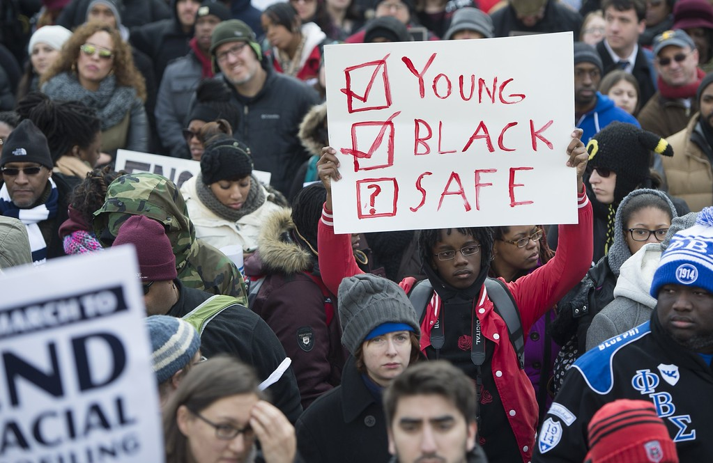 . Thousands take part in the Justice for All March and Rally down Pennsylvania Avenue through downtown Washington, DC, December 13, 2014, to protest the killings of unarmed African Americans by police officers and the decisions by Grand Juries to not indict them. AFP PHOTO / SAUL  LOEB/AFP/Getty Images