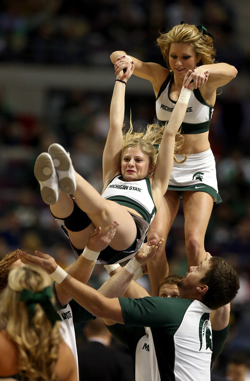 . Cheerleaders for the Michigan State Spartans perform against the Valparaiso Crusaders during the second round of the 2013 NCAA Men\'s Basketball Tournament at at The Palace of Auburn Hills on March 21, 2013 in Auburn Hills, Michigan.  (Photo by Jonathan Daniel/Getty Images)