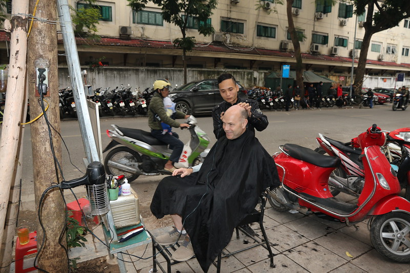 Michael says you haven't lived until you've gotten a haircut on the street for $3