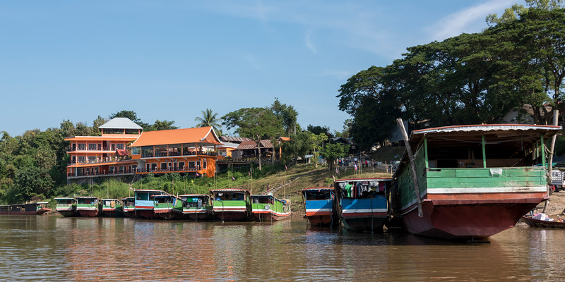 Houseboats along shoreline of River Mekong, Laos