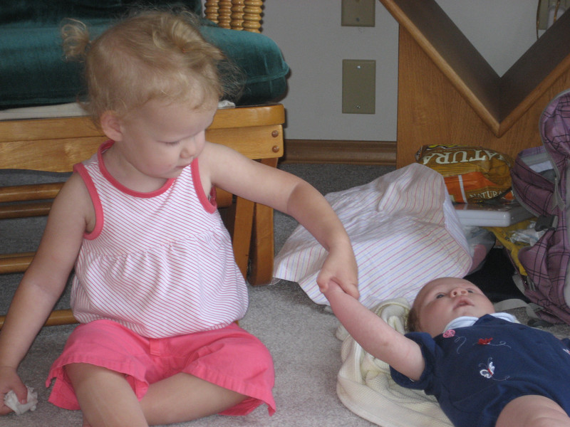 "Ellen teaching Emmie about her hands. ""open, close"""