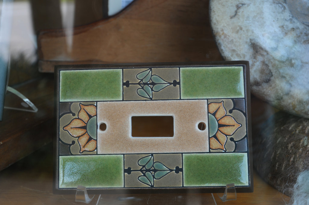 . A decorative ceramic light switch plate for sale at Bnox Gold and Iron Works, a fine art and jewelry store along the waterfront in Pepin, Wisconsin. (Pioneer Press: Ginger Pinson)
