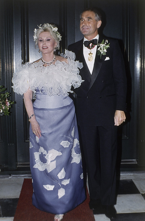 . File - Zsa Zsa Gabor with her eighth husband Prince Fredrick von Anhalt at her home in the Bel Air section of Los Angeles after their wedding at an evening ceremony on Aug. 14,1986.   Gabor wears a lavender and white off-the-shoulder gown.   Gabor died Sunday, Dec. 18, 2016, of a heart attack at her Bel-Air home, her husband, Prince Frederic von Anhalt, said. She was 99.  (AP Photo/Reed Saxon)