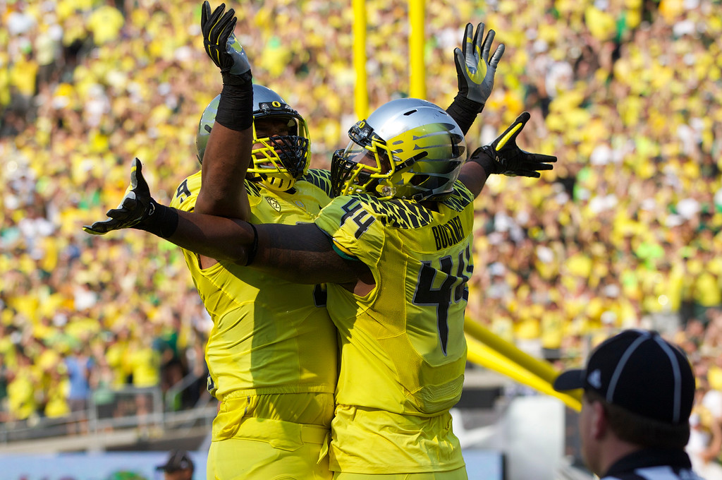 . Oregon Ducks defensive lineman DeForest Buckner (44) celebrates with defensive lineman Arik Armstead (9) after Buckner scored on an extra-points pass as the Ducks went ahead 8-0 against the Michigan State Spartans at Autzen Stadium Saturday, Sept. 6, 2014, in Eugene, Oregon. (AP Photo/The Oregonian,Randy Rasmussen )  MAGS OUT; TV OUT; LOCAL TELEVISION OUT; LOCAL INTERNET OUT; THE MERCURY OUT; WILLAMETTE WEEK OUT; PAMPLIN MEDIA GROUP OUT