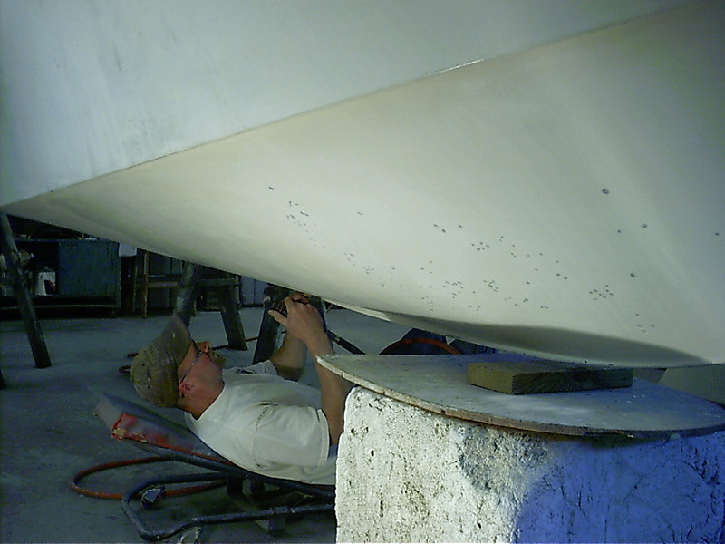 Grinding out bottom blisters and areas that need to be reglassed.