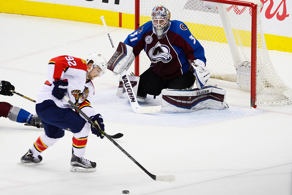 . DENVER, CO - MARCH 3: Florida Panthers center Kyle Rau (92) prepares to take a shot on Colorado Avalanche goalie Calvin Pickard (31) during the second period at the Pepsi Center on March 3, 2016 in Denver, Colorado. (Photo by Brent Lewis/The Denver Post)