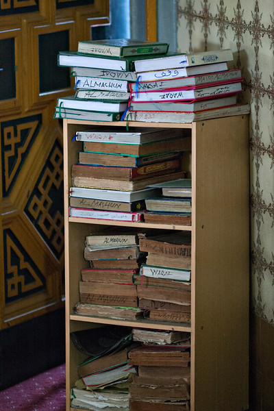 Korans stacked up for future use.