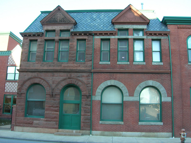 """Buildings across the street that were probably part of the brewing complex.  I believe that the triangles at the top of the structures say """"1892"""" and """"1896""""."""