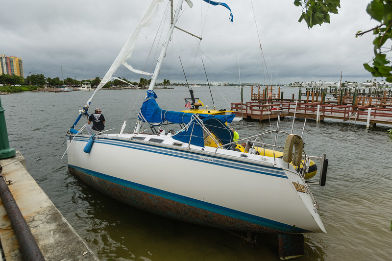 Hurricane Matthew pushed a sailboat against the Blue Heron Blvd. causeway near Phil Foster Park in Riviera Beach on Friday, October 7, 2016. (Joseph Forzano / The Palm Beach Post)