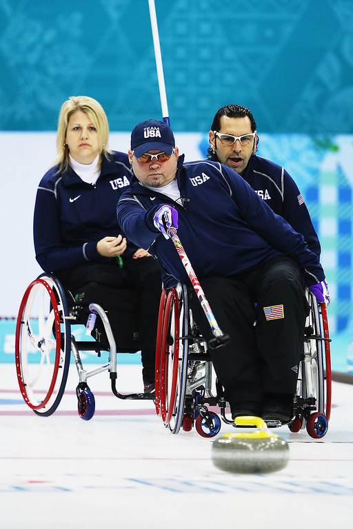 . Patrick McDonald of USA competes in the wheelchair curling mixed round robin match between USA and Slovakia at the Ice Cube Curling Center on March 8, 2014 in Sochi, Russia.  (Photo by Hannah Peters/Getty Images)