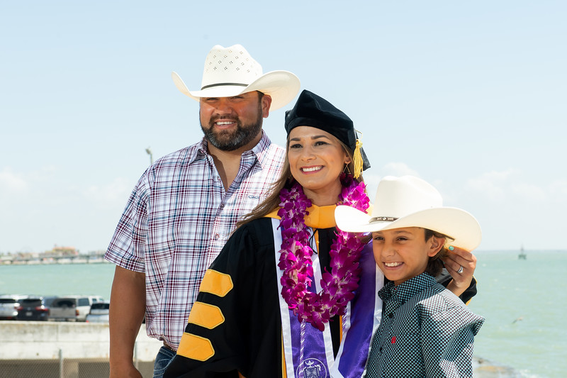Newly graduated Islander alumni celebrate with family and friends outside the American Bank Center.