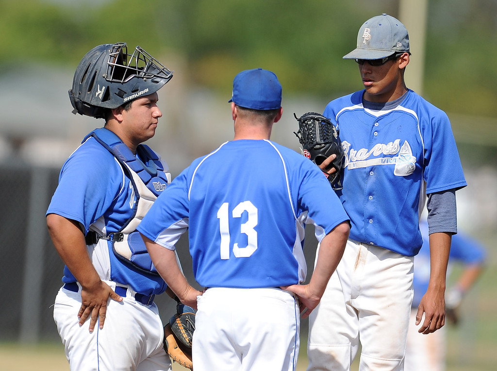 . Baldwin Park head coach Jake Barendregt (13) talks with starting pitcher Bernardo Flores ©, right, as catcher Daniel Escobedo looks on in the first inning of a prep baseball game at Northview High School on Tuesday, April 23, 2012 in Covina, Calif. Northview won 8-2.    (Keith Birmingham/Pasadena Star-News)