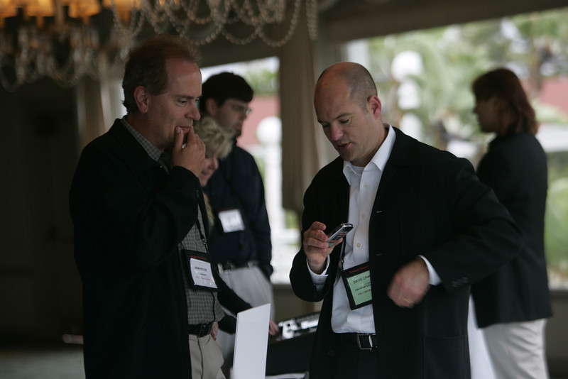 """""""Meet the FiReStarters and Spotlight Company"""": John Petote (L), CEO and Founder, CIO Solutions, learns more about vlingo from President and CEO Dave Grannan"""