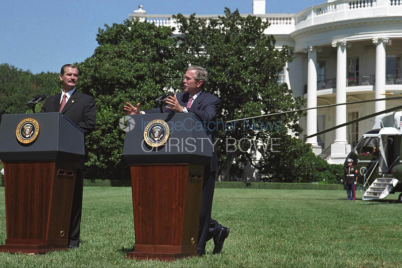President Bush holds a last minute press conference with President Fox of Mexico just prior to their departure on Marine One from the sout lawn of the White House.