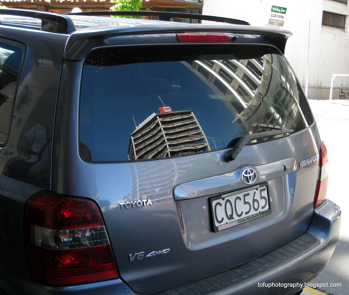 A building reflection in a rear car window in Christchurch, New Zealand in November 2010