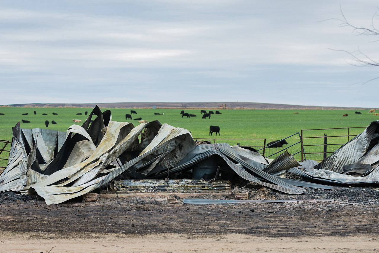 Photo by Dana Rich<br /> The raging fires destroyed everything in its path. Metal buildings were reduced to heaps of scrap after fire ravaged the land.