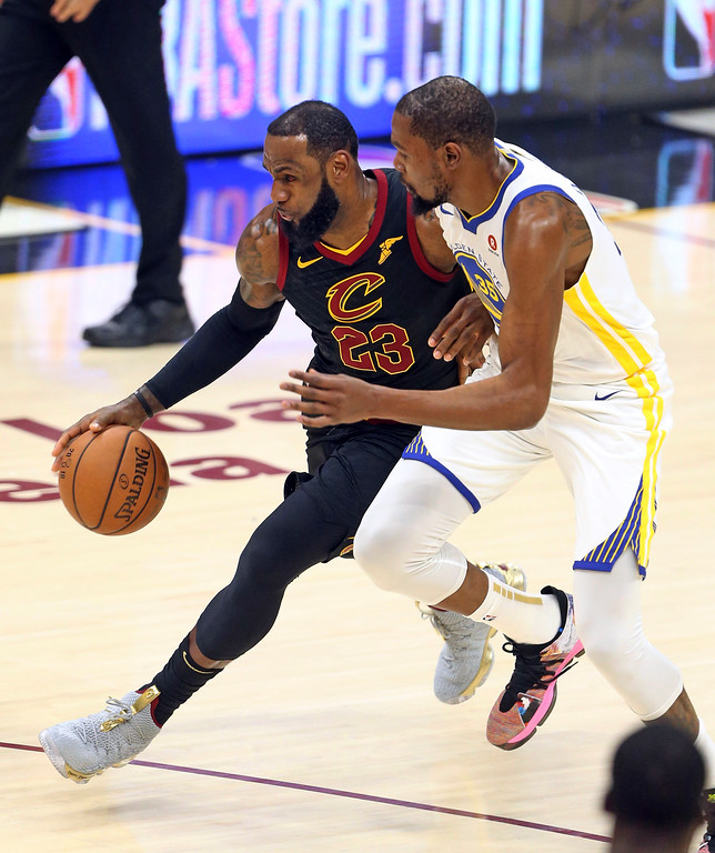 . Cleveland Cavaliers forward LeBron James drives against Golden State Warriors forward Kevin Durant during the first half of Game 3 of basketball\'s NBA Finals on Wednesday, June 6, 2018, in Cleveland. (Joshua Gunter/Cleveland.com via AP)