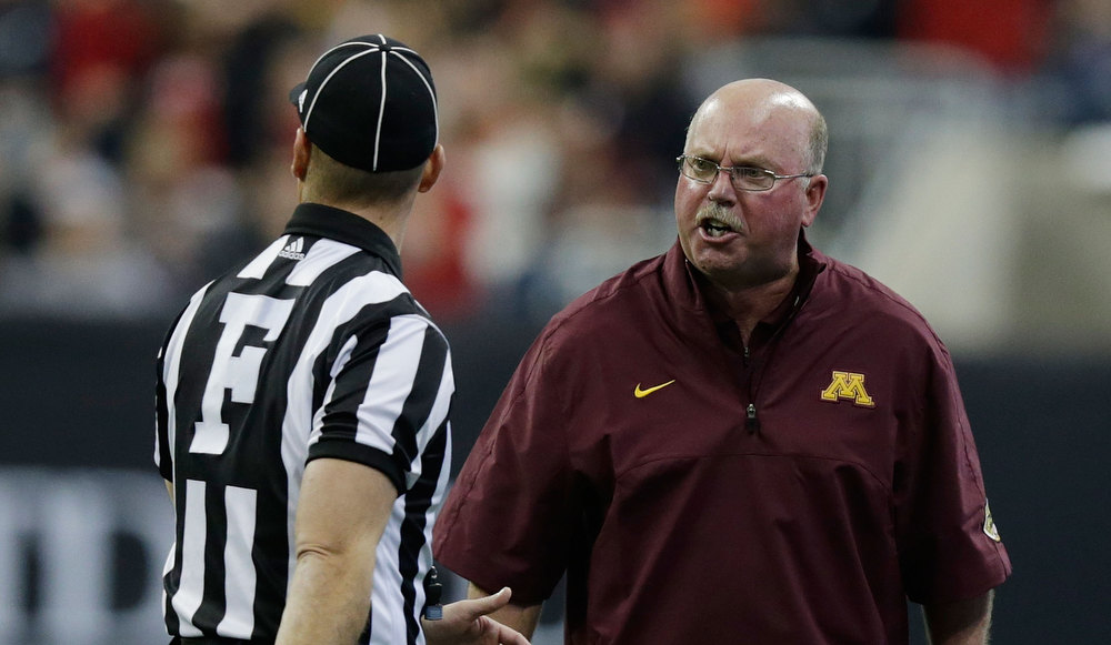 Description of . Minnesota head coach Jerry Kill argues a the call with Field Judge Matt Kukar during the game against Texas Tech during the Meineke Car Care of Texas Bowl at Reliant Stadium on December 28, 2012 in Houston, Texas.  (Photo by Scott Halleran/Getty Images)