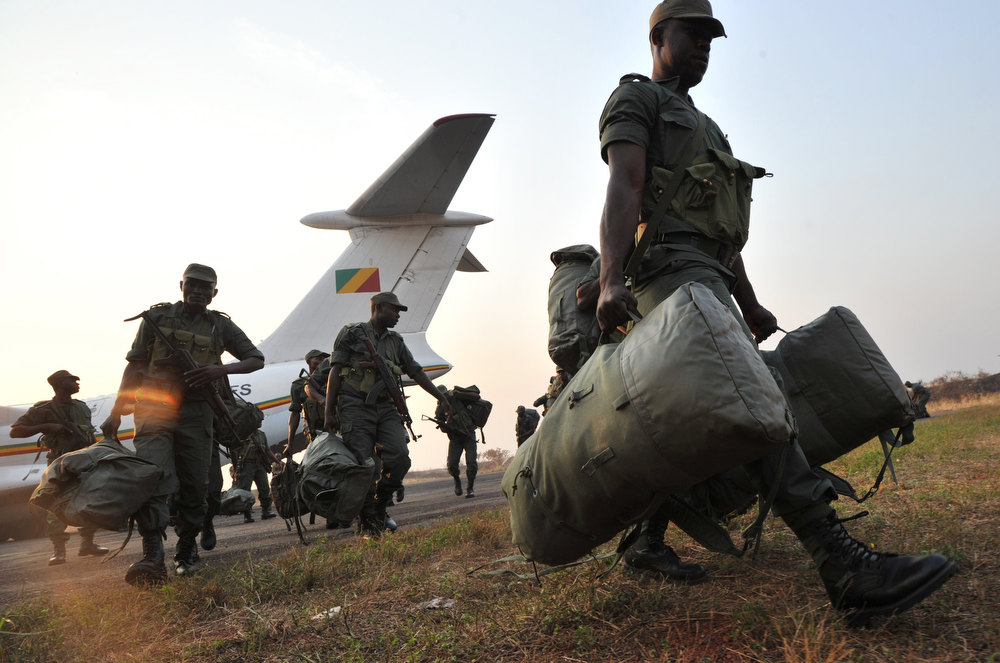 Description of . Soldiers from Congo Brazzaville, part of the Multinaional Force of the Economic Community of Central African States (FOMAC), arrive at the airport in Bangui, on December 31, 2012. Congo announced today the deployment of a battalion of 120 soldiers to the Central African Republic's capital Bangui at the request of the Tchadian President Idriss Deby, who is currently the president of FOMAC. Meanwhile rebels in the Central African Republic vowed to take the last key town before the capital and renewed their call for the president to stand down, voicing scepticism over his pledge to make concessions. SIA KAMBOU/AFP/Getty Images