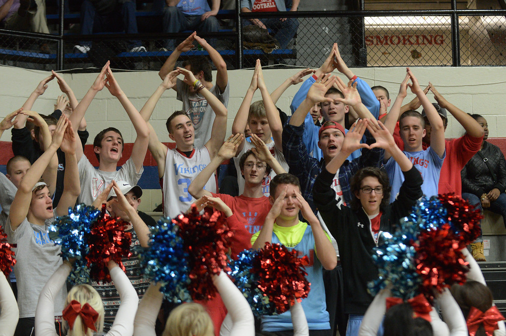 . Duncan Scott/DScott@News-Herald.com VASJ cheerleader lead the student section in a cheer during the third quarter. VASJ defeated Youngstown Ursuline 69-60 March 15 in the Division III regional final at Canton Memorial Fieldhouse.