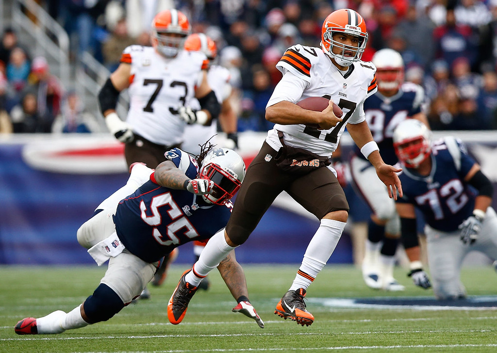 . Jason Campbell #17 of the Cleveland Browns runs with the ball past Brandon Spikes #55 of the New England Patriots in the first quarter during the game at Gillette Stadium on December 8, 2013 in Foxboro, Massachusetts.  (Photo by Jared Wickerham/Getty Images)