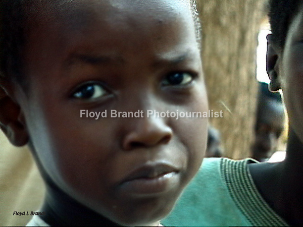 Floyd Brandt Photojournalist 40 days and nights in Cameroon Africa traveling from the South to the North.young boy who are kicked out of their homes try to make a living on the streets. They find themselves being controlled by a master who feeds them and gives them a place to live but they must bring money each day.