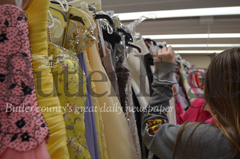 """Photo by Alexandria Mansfield.Students and their parents search through more than 2,000 prom dresses at the Cranberry Community United Presbyterian Church's annual """"I Found the Gown"""" sale on Saturday."""