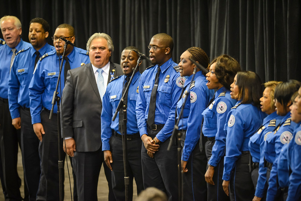 . The TSA LAX chorus sings at the memorial for slain TSA officer Gerardo Hernandez at the Los Angeles Sports Arena Tuesday, November 12, 2013.  A public memorial was held for Officer Hernandez who was killed at LAX when a gunman entered terminal 3 and opened fire with a semi-automatic rifle, Grigsby was wounded in the attack.  ( Photo by David Crane/Los Angeles Daily News )