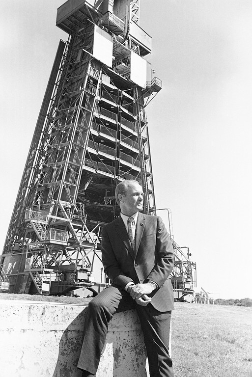 . Former astronaut John Glenn poses at base of the launch pad on Feb. 23, 1972 in Cape Kennedy, Fla., from which he was launched 10 years ago as the first American to orbit the earth. The service tower in the background cradled the Atlas rocket that hoisted Glenn into space Feb. 20, 1962. The 50-year-old former Marine Lieutenant colonel returned to the launch site Tuesday for the 10th anniversary celebration of his flight. (AP Photo/Jim Kerlin)