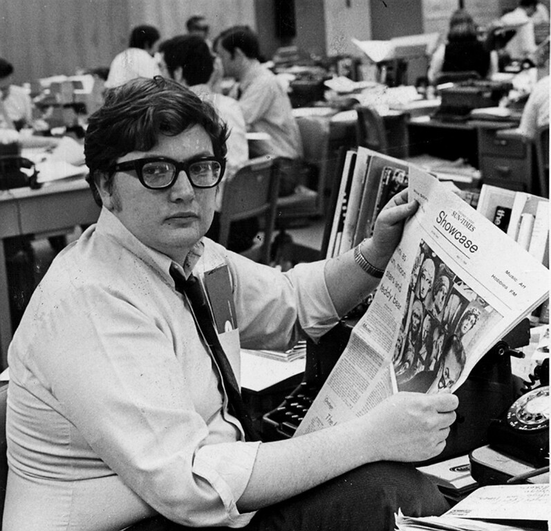 . This 1969 photo shows Chicago Sun-Times movie critic Roger Ebert in the newsroom of the paper in Chicago. Ebert, the most famous and popular film reviewer of his time who became the first journalist to win a Pulitzer Prize for movie criticism and, on his long-running TV program, wielded the nation\'s most influential thumb, died Thursday, April 4, 2013. He was 70. (AP Photo/Chicago Sun-Times, Bob Kotalik)