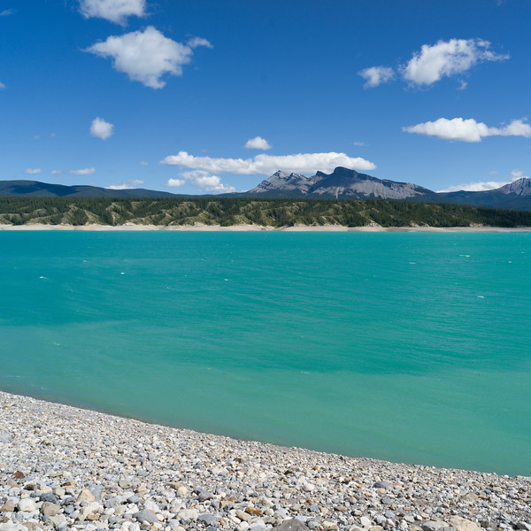 Scenic view of Abraham Lake with mountains in the background, David Thompson Highway, Clearwater County, Alberta, Canada