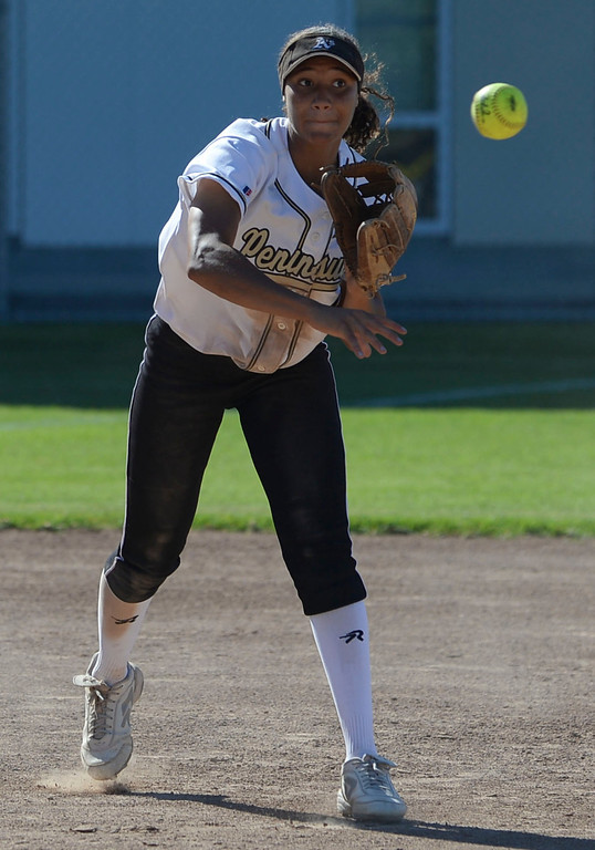 . Peninsula shortstop Brooke Vines (4) rockets a throw to first for an out on Arroyo Grande in a CIF Southern Section Division III wild-card softball game in Rolling Hills Estates Tuesday. Peninsula won the game 13-0. 20130514 Photo by Steve McCrank / Staff Photographer